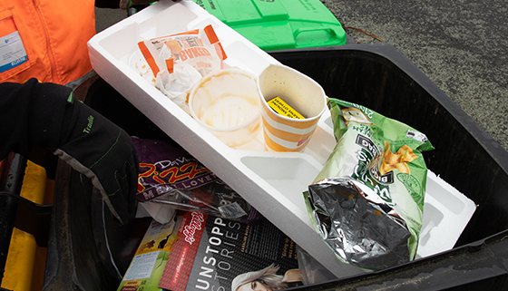 Recycling bin filled with household rubbish