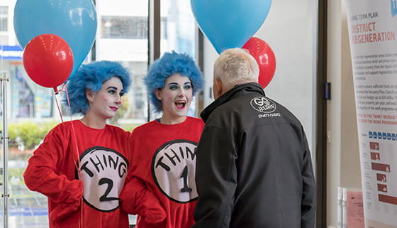 Image of Thing 1 and Thing 2 with member of public