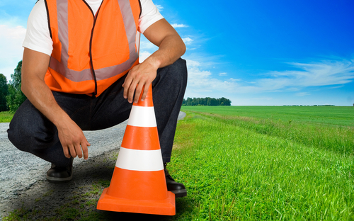 Man with road cone