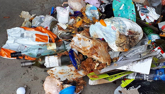 Food waste, nappies and rubbish mixed with recyclables