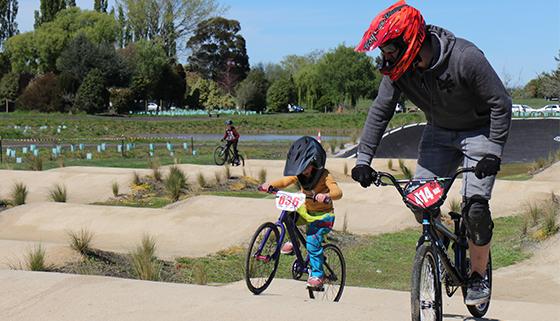 Family riding on the Kaiapoi BMX track
