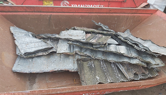 Decramastic roof tiles containing asbestos