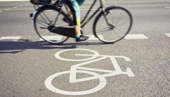 Cyclist uses painted cycleway.