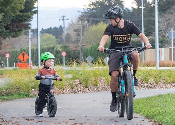 Father and child biking along Woodend Shared Path