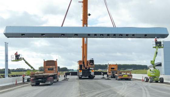A toll plaza being installed over a motorway
