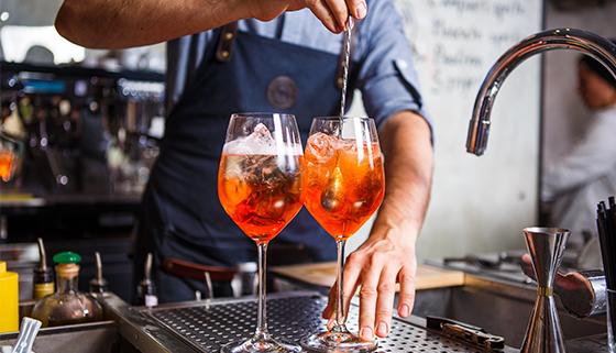 Barman making drinks at a bar