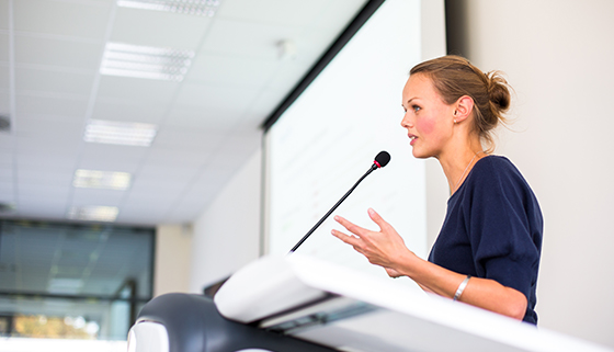 Presenter at a lecturn
