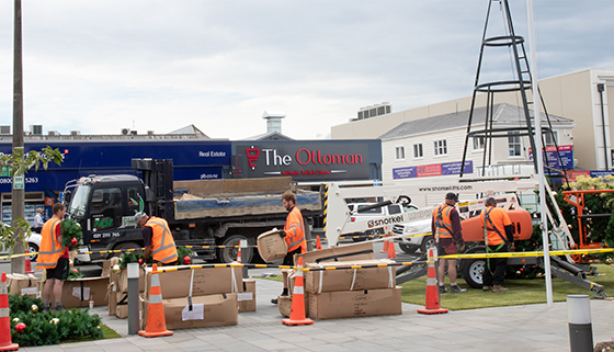Large display Christmas tree being installed by contractors outside the Rangiora Service Centre